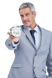 Businessman showing alarm clock Royalty Free Stock Photography