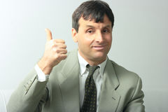 Businessman showing allright Royalty Free Stock Images