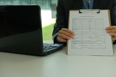 Businessman showing auto insurance quote request. Form stock photos