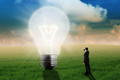 Businessman showing big light bulb Royalty Free Stock Image