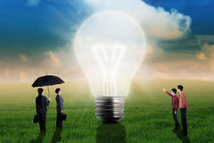 Businessman showing big light bulb Royalty Free Stock Photo