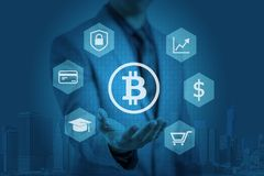 Businessman is showing bitcoin graphic on hands Royalty Free Stock Images