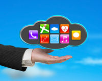 Businessman showing black cloud with app icons and sky backgroun Royalty Free Stock Images