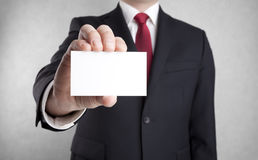 Businessman showing blank business card Stock Images