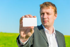 Businessman showing blank   card Stock Image