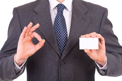 Businessman showing blank card. Royalty Free Stock Photos