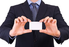 Businessman showing blank card. Royalty Free Stock Images