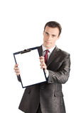 Businessman showing a blank clipboard Stock Photo
