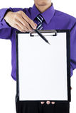 Businessman showing a blank clipboard Royalty Free Stock Images