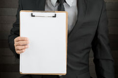 Businessman showing blank document Royalty Free Stock Image