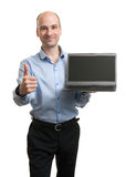 Businessman showing blank laptop computer Royalty Free Stock Image