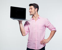 Businessman showing blank laptop screen Royalty Free Stock Photography