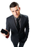 Businessman showing blank smartphone screen Royalty Free Stock Photo