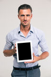 Businessman showing blank tablet computer screen Royalty Free Stock Images