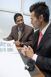 Businessman Showing Blueprints To His Business Partner Stock Image