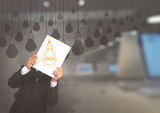 Businessman showing the book of drawing idea light bulb Royalty Free Stock Photography