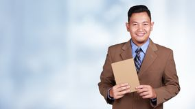 Businessman Showing Book stock image