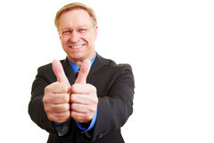 Businessman showing both thumbs up Stock Images