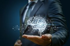 Businessman showing the brain as part . Royalty Free Stock Images