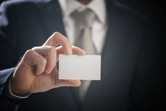 Businessman showing business card - focus on fingers and card Stock Images