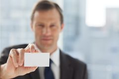 Businessman showing business card Stock Photo