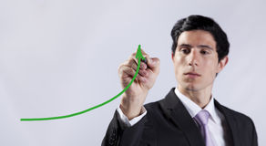 Businessman showing the business progress Stock Image