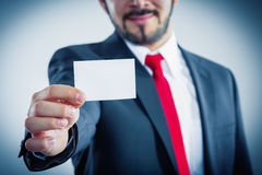 Businessman showing businesscard. Businessman is showing his bussinesscard without face Royalty Free Stock Photo