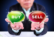Businessman showing buy or sell Stock Photos