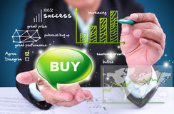 Businessman showing buy trading sign. With map, green bar chart and buy icon Royalty Free Stock Image