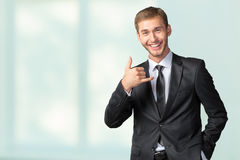 Businessman showing Call me sign Stock Image