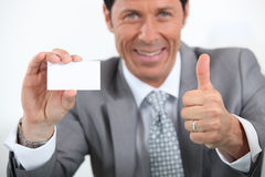 Businessman showing card Royalty Free Stock Photography