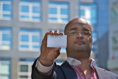 Businessman showing card Stock Photography