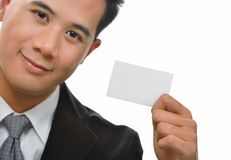Businessman showing  card. Royalty Free Stock Photography