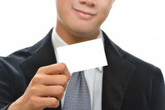 Businessman showing  card. Stock Image