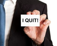 Businessman showing card with i quit sign Stock Image