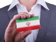 Businessman showing card, matte paper effect Stock Image