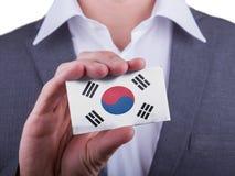 Businessman showing card, matte paper effect stock images