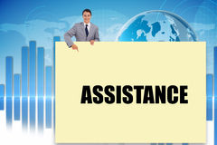 Businessman showing card saying assitance Stock Images
