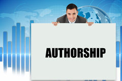 Businessman showing card saying authorship Royalty Free Stock Photos