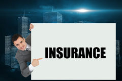 Businessman showing card saying insurance Royalty Free Stock Photo