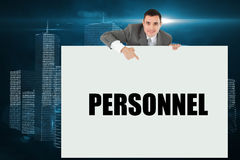 Businessman showing card saying personnel. Against digital background stock photos