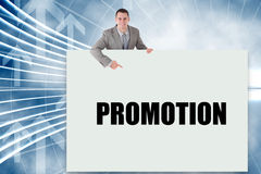 Businessman showing card saying promotion Stock Photo