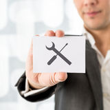 Businessman Showing Card for Service Concept Stock Photo