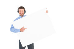 Businessman showing card wearing headset Stock Photo