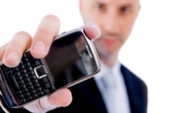 Businessman showing cellphone Royalty Free Stock Photo