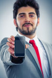 Businessman showing cellphone display. Just put your text here Royalty Free Stock Photos
