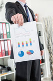 Businessman showing charts and graphics Royalty Free Stock Image
