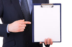 Businessman showing clipboard. Stock Image