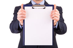 Businessman showing clipboard. Royalty Free Stock Photo
