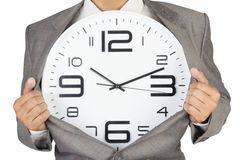Businessman showing clock in suit Royalty Free Stock Photos
